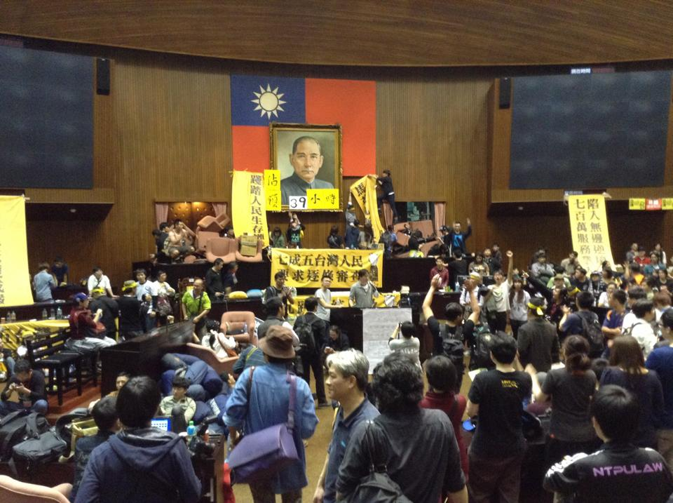 Demonstrators occupy the floor and speaker's box